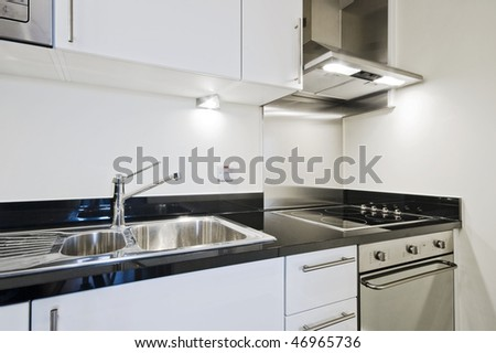 modern luxury kitchen counter with electric appliances and granite worktop - stock photo