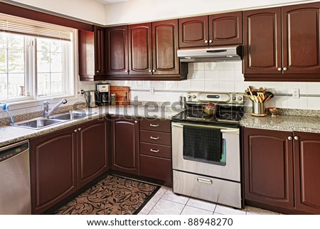 Modern luxury kitchen interior with granite countertop and appliances - stock photo
