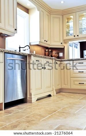Modern luxury kitchen with ceramic tile floor - stock photo