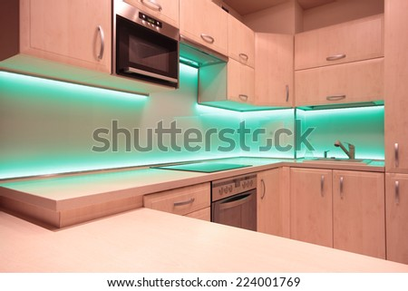 Modern luxury kitchen with green LED lighting - stock photo