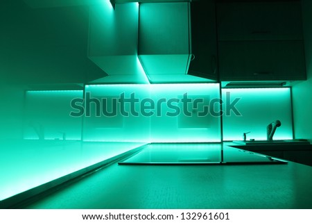 modern luxury kitchen with turquoise led lighting
