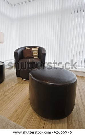 modern luxury leather armchair and matching feet rest - stock photo