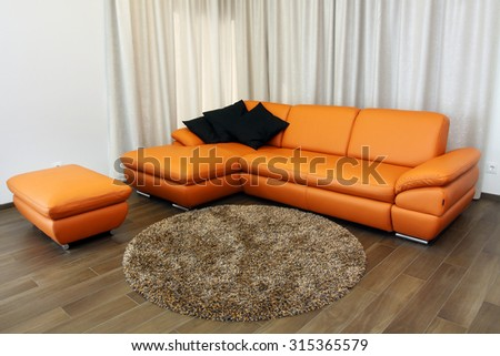 Modern luxury living room with orange corner sofa - stock photo