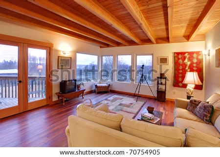 Modern luxury living room with wood ceiling and large windows - stock photo