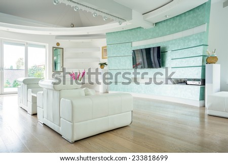 Modern luxury lounge with wooden floor - stock photo