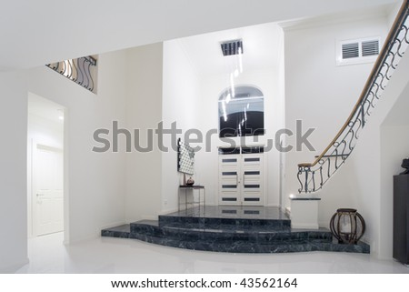 Modern luxury mansion entrance with marble stairs