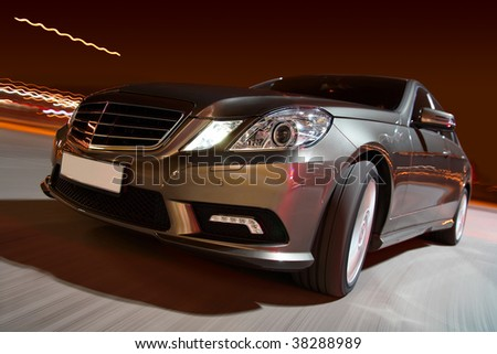Modern luxury sedan driving fast - stock photo