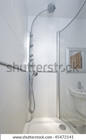 modern luxury shower cabin with fixed sprinkler and shower attachment - stock photo