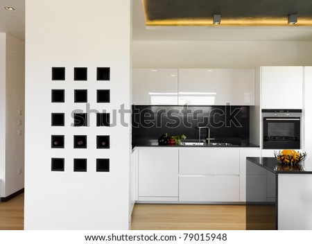 modern luxury white kitchen with wood floor - stock photo