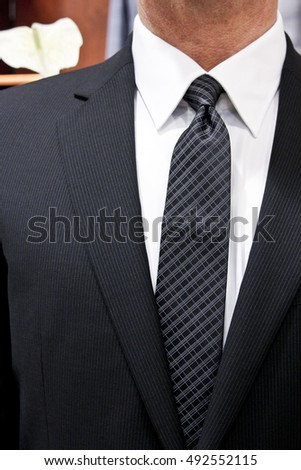 modern man is wearing a suit and tie, Handkerchief in suit