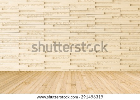 Modern marble tile wall pattern  background in light cream beige color with wooden floor in yellow cream tone : Horizontal marble rock stone tiled pattern texture backdrop with wood flooring  - stock photo