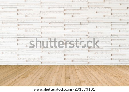 Modern marble tile wall pattern background in light white beige color with wooden floor in yellow brown tone : Horizontal marble rock stone tiled pattern texture backdrop with wood flooring  - stock photo