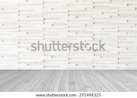 Modern marble tile wall pattern textured background in light white beige color with wooden floor in grey tone : Horizontal marble rock stone tiled pattern texture backdrop with wood flooring  - stock photo