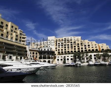 Modern marina and apartments in the Mediterranean island of Malta - stock photo