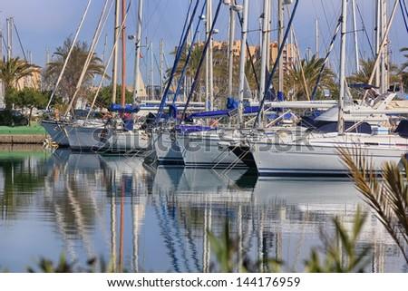 modern marina filled with sailboats docked - stock photo