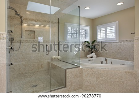 Modern master bath with large glass shower - stock photo