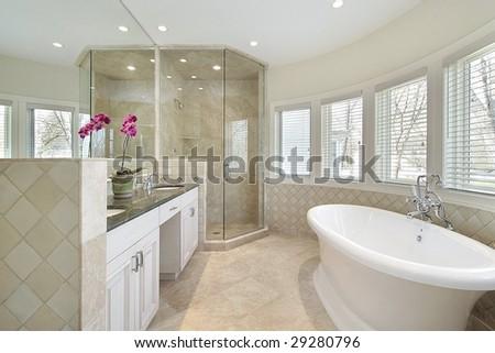 Modern master bath with large tub - stock photo