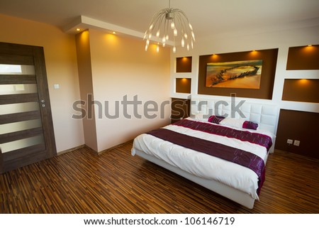 Modern master bedroom interior with picture of shipwreck. (photo of shipwreck coming from my gallery and is printed on canvas) - stock photo