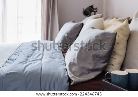 modern master bedroom with pillows at home - stock photo