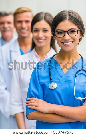 Modern medicine. Group successful doctors in hospital background - stock photo