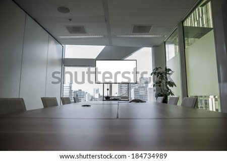 Modern meeting room with equipment for teleconference - stock photo