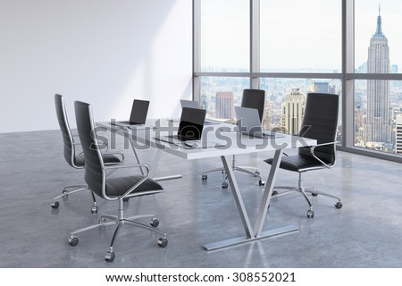 Modern meeting room with huge windows looking at New York City. Black leather chairs and a white table with laptops. 3D rendering. - stock photo