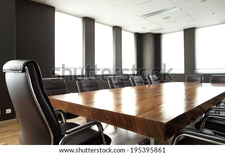 Modern meeting room with solid wood table - stock photo
