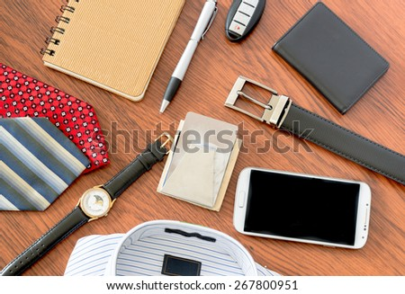Modern men's clothing and accessories on luxurious wooden background - stock photo
