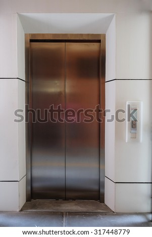 modern metal elevator close door in building office