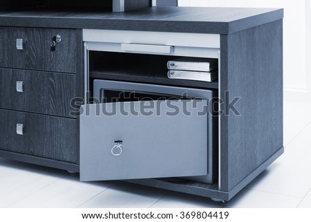 modern metal safe in a office - stock photo