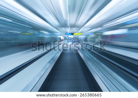 Modern metal travelator moving inside airport