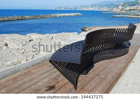 Modern metallic bench by the sea, Santo Stefano al Mare, Liguria, Italy - stock photo