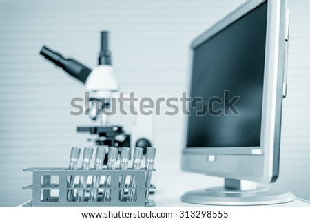 Modern microscope station with tissue section on the screen - stock photo