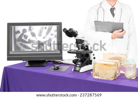 modern microscope with a doctor with liver fluke  - stock photo