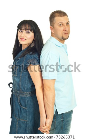Modern mid adult couple standing back to back and holding hands isolated on white background