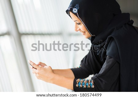 modern middle eastern woman using smart phone - stock photo