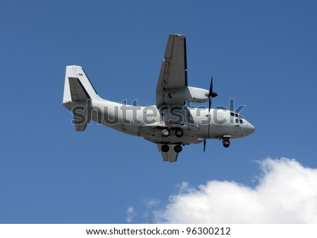 Modern military transport airplane in flight - stock photo