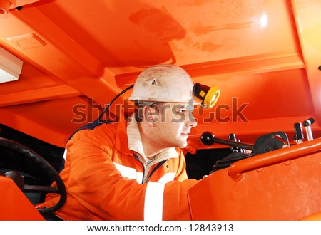 Modern miner working in a mine shaft stock photo