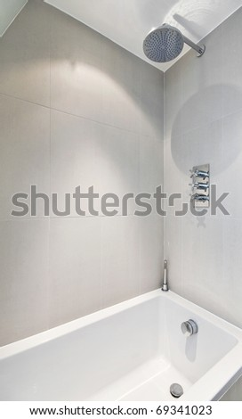 modern minimal style bath with built in large sprinkler - stock photo