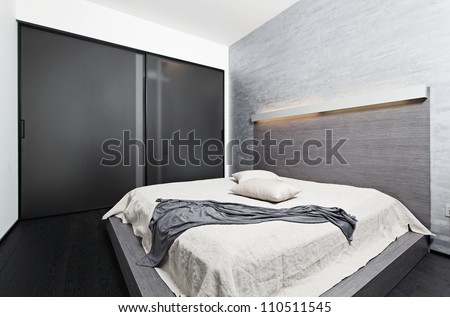 Modern minimalism style bedroom interior in beige tones - stock photo
