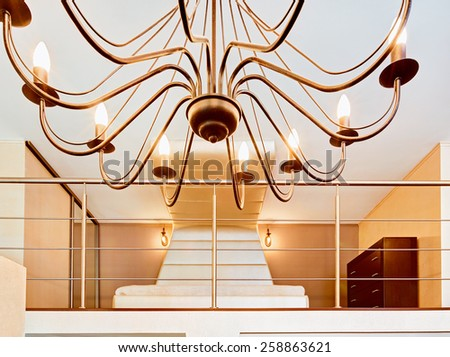 Modern minimalism style bedroom through chandelier view - stock photo