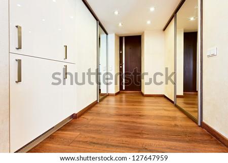 Modern minimalism style corridor interior with sliding-door mirror wardrobe - stock photo