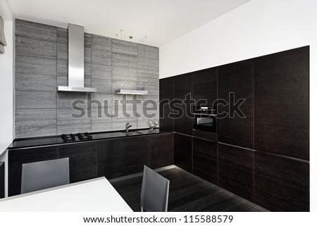 Modern minimalism style kitchen interior in monochrome tones - stock photo