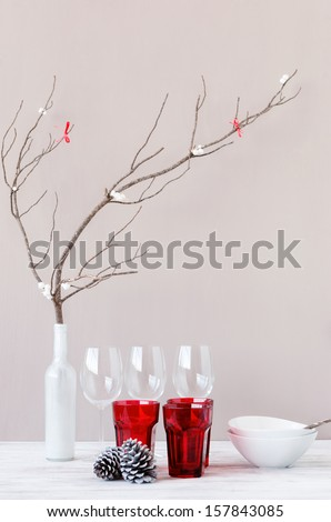 Modern minimalist christmas table setting decoration with pine cone and bare branch, simple neutral and rustic - stock photo