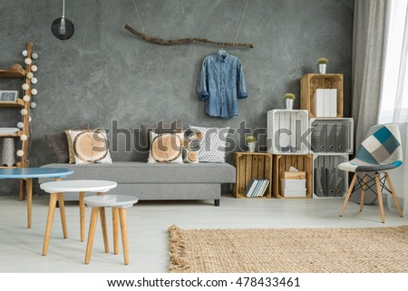 modern minimalistic living room interior in shades of cyan with sofa chair three coffee