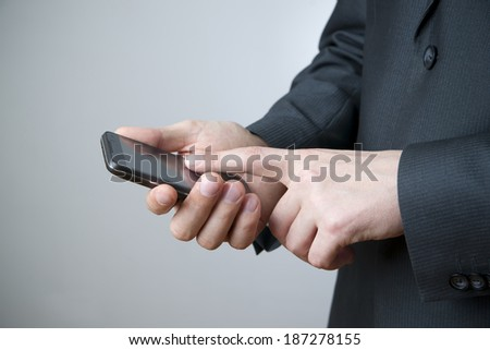 Modern mobile phone in male hand. Businessman using smartphone