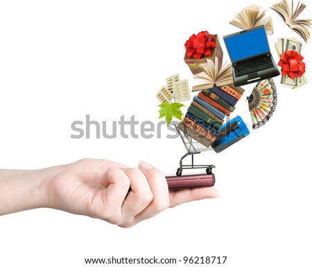 Modern mobile phone in the hand with lots of goods isolated on white (e-shopping concept) - stock photo