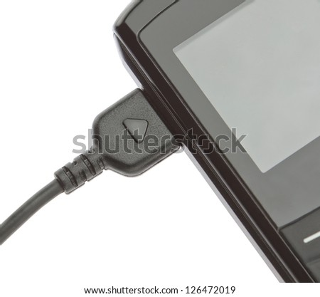 Modern mobile phone on charge. On a white background. - stock photo