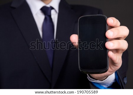 modern mobile phone with blank screen in business man hand