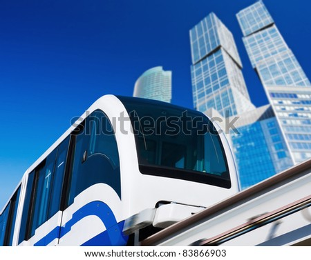 modern monorail in the city of skyscrapers - stock photo